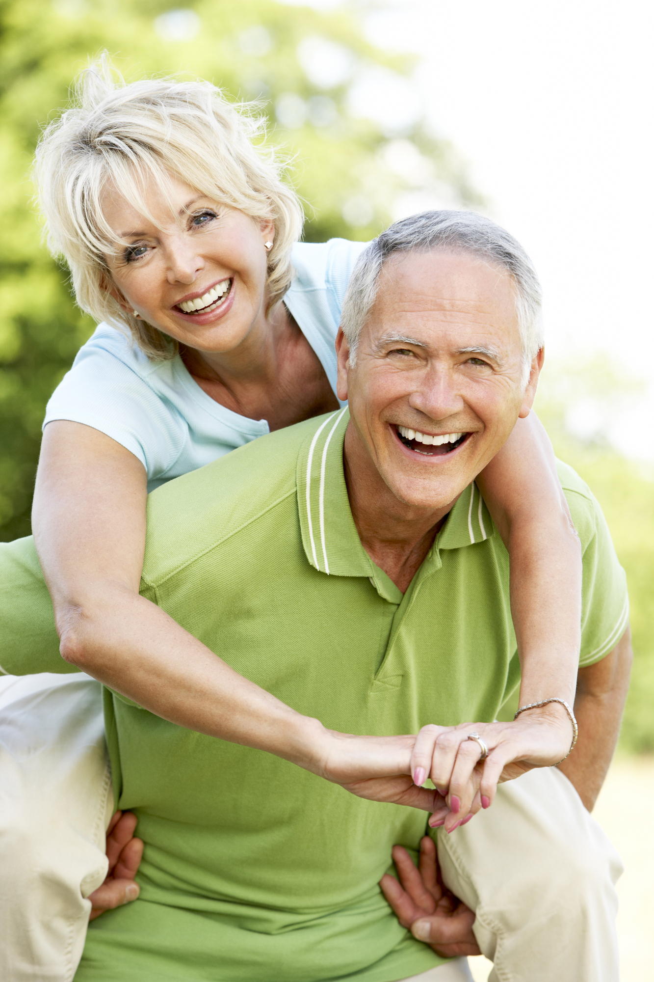 Happy older couple who have a happy active life helped by having custom dentures created for them at Boca Smile Center in Boca Raton, FL.