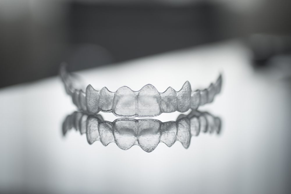 Image of invisalign top tray sitting on a counter.
